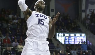 TCU forward JD Miller (15) attempts the slam dunk during the first half of an NCAA college basketball game against SMU in Fort Worth, Texas, Tuesday, Dec. 5, 2017. (AP Photo/LM Otero)