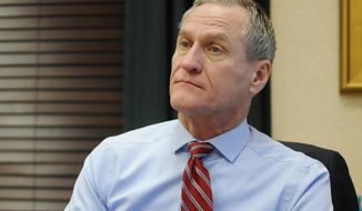 FILE - In this Dec. 28, 2016 file photo, South Dakota Gov. Dennis Daugaard describes his priorities for the rest of his term at the state Capitol in Pierre, S.D. Daugaard said Monday, Dec. 4, 2017, that money will be tight for South Dakota's current and upcoming budget years ahead of his yearly budget address to the state Legislature on Tuesday, Dec. 5. (AP Photo/James Nord, File)
