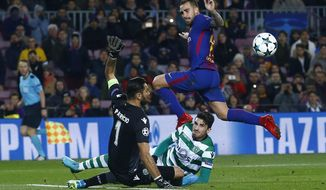 Barcelona's Paco Alcacer, up, jumps over Sporting goalkeeper Rui Patricio, left, during the Champions League Group D soccer match between FC Barcelona and Sporting CP at the Camp Nou stadium in Barcelona, Spain, Tuesday, Dec. 5, 2017. (AP Photo/Manu Fernandez)