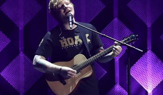 FILE - In this Dec. 1, 2017, file photo, Ed Sheeran performs at Jingle Ball at The Forum in Inglewood, Calif. The Grammys may have dissed Sheeran, but Spotify says he's the most streamed artist of the year. The streaming service announced Tuesday, Dec. 5, that Sheeran tops its 2017 list with 6.3 billion streams. (Photo by John Salangsang/Invision/AP, File)
