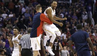 Arizona guard Parker Jackson-Cartwright, right, celebrates with a teammate after defeating Texas A&M 67-64 during an NCAA college basketball game, Tuesday, Dec 5, 2017, in Phoenix. (AP Photo/Rick Scuteri)