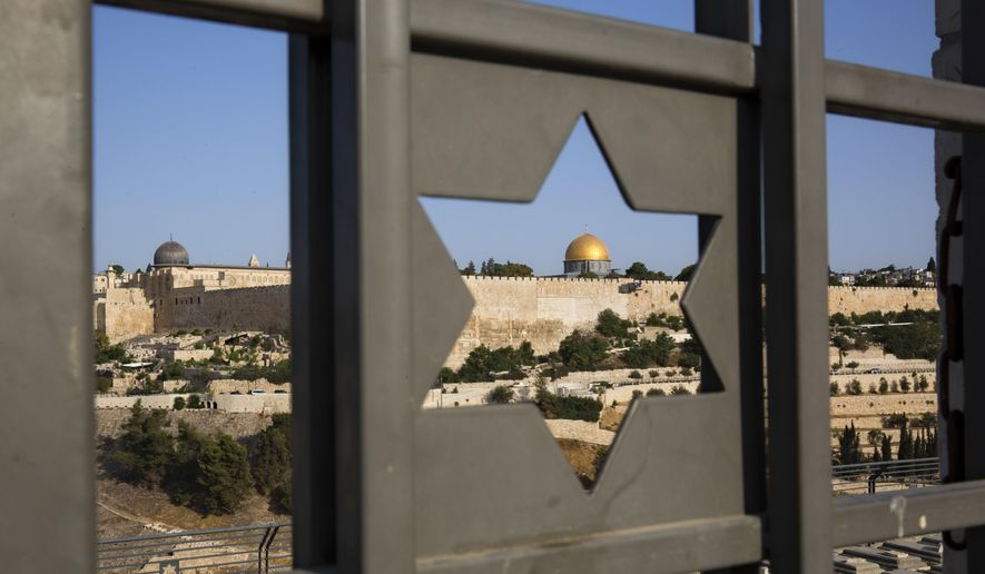 In this July 25, 2017 file photo, Jerusalem's Old City is seen trough a door with the shape of star of David.  (AP Photo/Oded Balilty, File) **FILE**