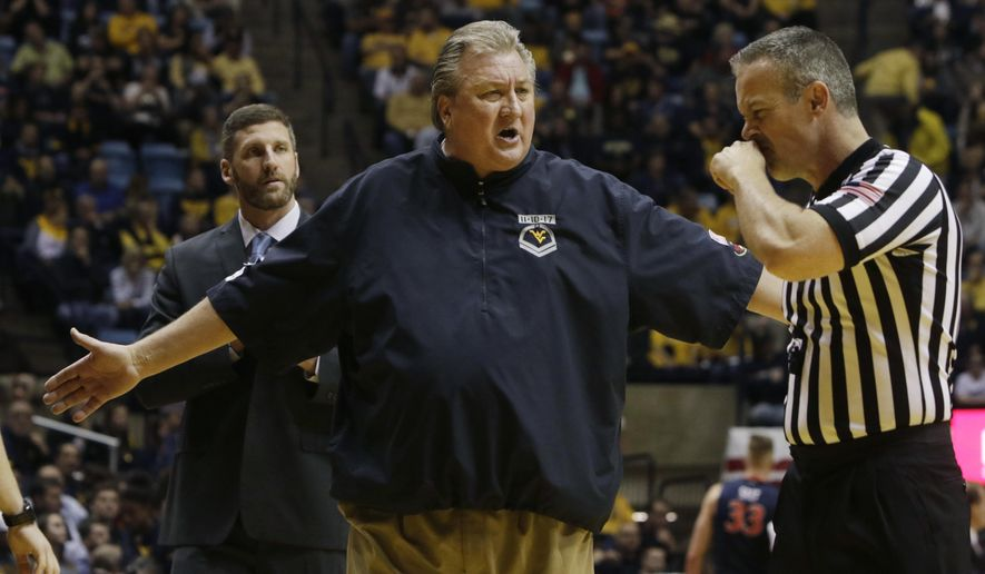 West Virginia head coach Bob Huggins yells to a referee during the first half of the team's NCAA college basketball game against Virginia, Tuesday Dec. 5, 2017, in Morgantown, W.Va. (AP Photo/Raymond Thompson)