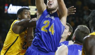 South Dakota State's Mike Daum fights for a rebound with Wichita State's Darrel Willis, left, during the first half of an NCAA college basketball game at Koch Arena in Wichita, Kan., Tuesday, Dec. 5, 2017. (Fernando Salazar/The Wichita Eagle via AP)