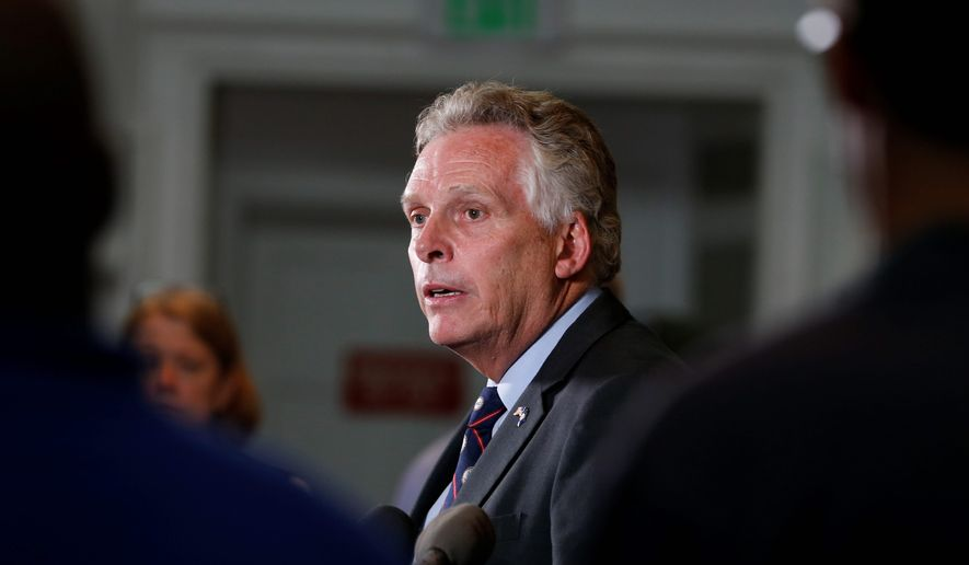 Virginia Gov. Terry McAuliffe has said Virginia will not budge on funding Metro unless its Board of Directors is downsized from 16 to a more manageable figure. (Associated Press)