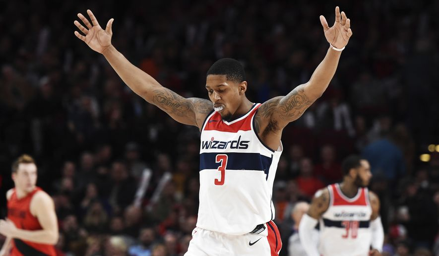 Washington Wizards guard Bradley Beal reacts after hitting a shot during the second half of the team's NBA basketball game against the Portland Trail Blazers in Portland, Ore., Tuesday, Dec. 5, 2017. Beal scored 51 points as the Wizards won 106-92 (AP Photo/Steve Dykes)