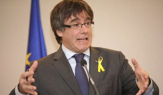 Ousted Catalan leader Carles Puigdemont speaks during a media conference in Brussels on Wednesday, Dec. 6, 2017. Catalan secessionist leader Carles Puigdemont and four close allies addressed the decision by Spain to drop a European arrest warrant against them and assessed the Dec. 21 elections in the Spanish region, which will help determine the drive for independence. (AP Photo/Olivier Matthys)