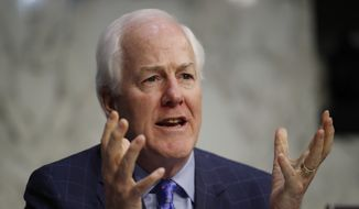 """Our Democratic colleagues simply refused to participate in the process,"" said Sen. John Cornyn, Texas Republican. ""We probably could have made it better if they had."" (Associated Press/File)"