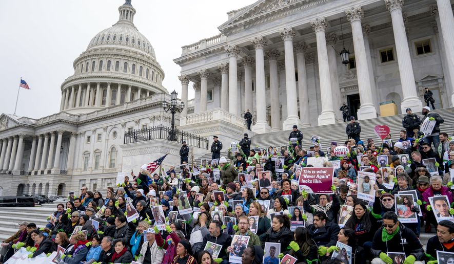 Demonstrators sit on the Senate steps before they are arrested outside of the U.S. Capitol during an immigration rally in support of the Deferred Action for Childhood Arrivals (DACA), and Temporary Protected Status (TPS), programs, on Capitol Hill, Wednesday, Dec. 6, 2017, in Washington. (AP Photo/Andrew Harnik) **FILE**