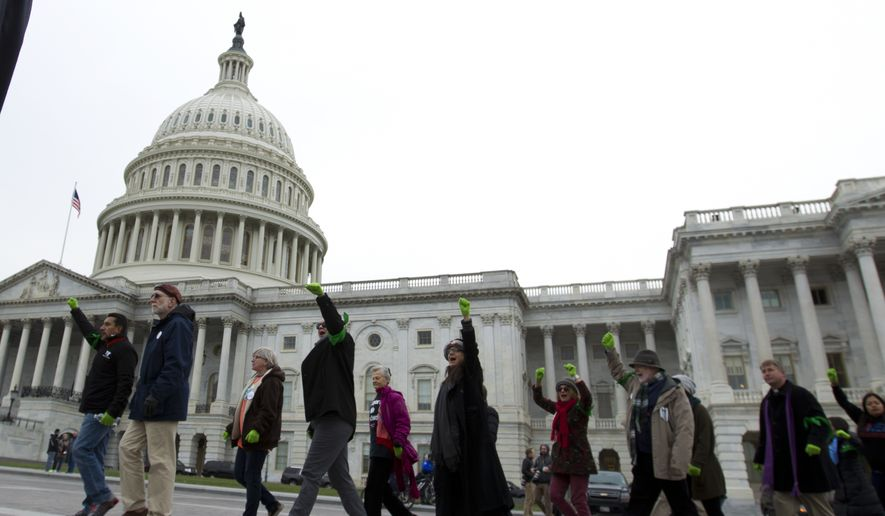 Demonstrators are arrested outside of the U.S. Capitol during an immigration rally in support of the Deferred Action for Childhood Arrivals (DACA), and Temporary Protected Status (TPS), programs, on Capitol Hill in Washington, Wednesday, Dec. 6, 2017. ( AP Photo/Jose Luis Magana)