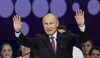 Russian President Vladimir Putin gestures as he speaks at the annual Volunteer of Russia 2017 award ceremony at the Megasport Sport Palace in Moscow, Russia, Wednesday, Dec. 6, 2017. Putin has moved an inch closer to announcing his intention to seek re-election in the next March's vote, saying he would weigh the move based on public support. (AP Photo/Ivan Sekretarev) **FILE**