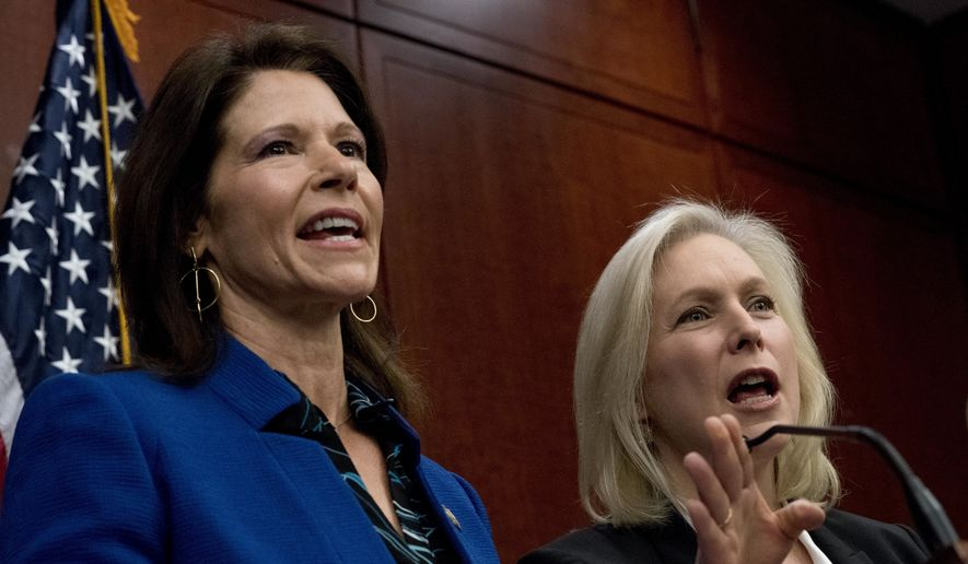 Rep. Cheri Bustos, D-Ill., left, and Sen. Kirsten Gillibrand, D-N.Y., right, speak at a news conference where members of congress have introduced legislation to curb sexual harassment in the workplace, on Capitol Hill, Wednesday, Dec. 6, 2017, in Washington. Gillibrand and fellow female Democratic senators have united in calling for Sen. Al Franken to resign amid sexual misconduct allegations. (AP Photo/Andrew Harnik)