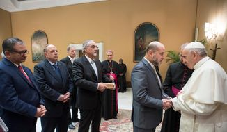 "Pope Francis meets with a delegation of Palestinian religious and intellectual representatives, at the Vatican, Wednesday, Dec. 6, 2017. Pope Francis called Wednesday for the status quo of Jerusalem to be respected and for ""wisdom and prudence"" to prevail to avoid futher conflict, hours before the expected announcement that the U.S. is recognizing Jerusalem as Israel's capital. (L'Osservatore Romano/Pool Photo via AP)"