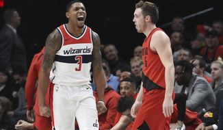 Washington Wizards guard Bradley Beal reacts after hitting a shot as Portland Trail Blazers guard Pat Connaughton walks nearby during the second half of an NBA basketball game in Portland, Ore., Tuesday, Dec. 5, 2017. Beal scored 51 points as the Wizards won 106-92 (AP Photo/Steve Dykes)