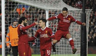 Liverpool's Philippe Coutinho, center, celebrates with his teammates after scoring his side's fifth goal during the Champions League Group E soccer match between Liverpool and Spartak Moscow at Anfield, Liverpool, England, Wednesday, Dec. 6, 2017. (AP Photo/Rui Vieira)