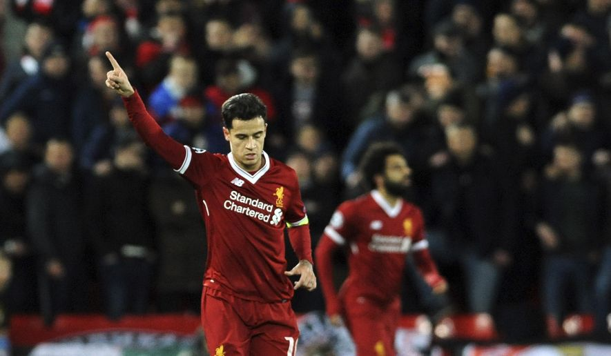 Liverpool's Philippe Coutinho, left, celebrates after scoring his side's second goal during the Champions League Group E soccer match between Liverpool and Spartak Moscow at Anfield, Liverpool, England, Wednesday, Dec. 6, 2017. (AP Photo/Rui Vieira)