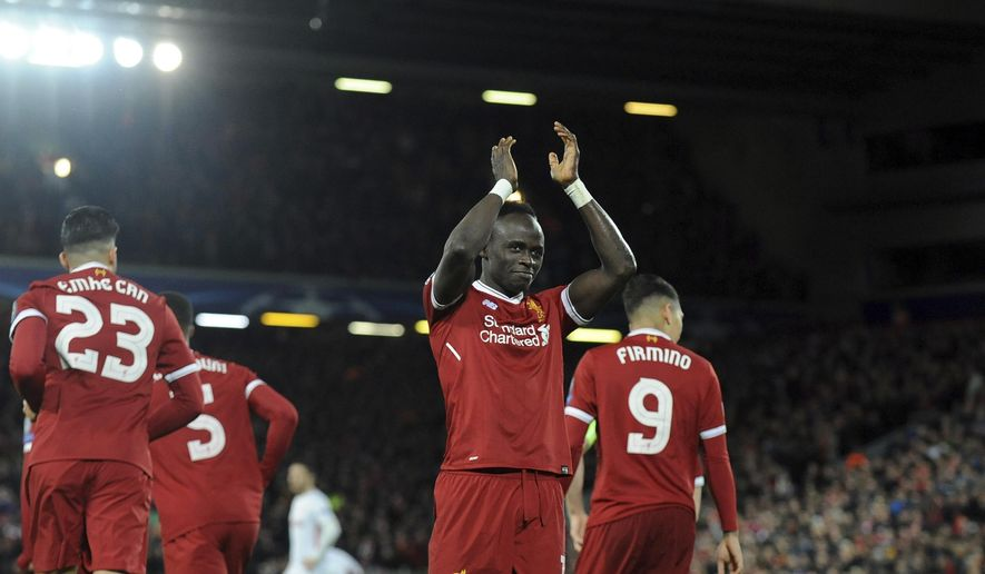 Liverpool's Sadio Mane, center, celebrates after scoring his side's fourth goal during the Champions League Group E soccer match between Liverpool and Spartak Moscow at Anfield, Liverpool, England, Wednesday, Dec. 6, 2017. (AP Photo/Rui Vieira)