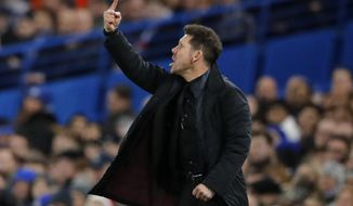 Atletico coach Diego Simeone gives directions during the Champions League Group C soccer match between Chelsea and Atletico Madrid at Stamford Bridge stadium in London Tuesday, Dec. 5, 2017. (AP Photo/Frank Augstein)