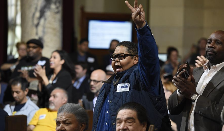 Donnie Anderson, co-founder and chairman of the California Minority Alliance, reacts after the Los Angeles City Council voted unanimously to approve new regulations for the marijuana industry on Wednesday, Dec. 6, 2017, in Los Angeles. (AP Photo/Chris Pizzello)