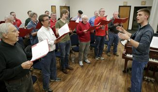 In this Thursday, Nov. 30, 2017 photo, music director Garrett Debbink, far right, leads a practice for the Madison Maennerchor at Madison Turners in Madison, Wis. (Michael P. King/Wisconsin State Journal via AP)
