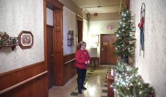 ADVANCE FOR MONDAY, DEC.10 The Rev. Carol Smith walks down the hallway in the recently renovated Mary Anne's Wing Friday, Dec. 1, 2017, at the Place of Hope in St. Cloud, Minn. The wing is designed to house up to 12 single women. (Dave Schwarz/St. Cloud Times via AP)