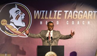 Willie Taggart gestures as he is introduced as Florida State's new football coach during an NCAA college football news conference in Tallahassee, Fla., Wednesday, Dec. 6, 2017. (AP Photo/Mark Wallheiser)