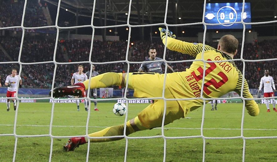 Besiktas' Alvaro Negredo, back, scores the opening goal past Leipzig goalkeeper Peter Gulacsi during the Champions League Group G soccer match between RB Leipzig and Besiktas JK in Leipzig, Germany, Wednesday, Dec. 6, 2017. (AP Photo/Michael Sohn)