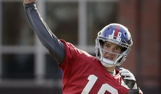 New York Giants quarterback Eli Manning throws during an NFL football practice in East Rutherford, N.J., Wednesday, Dec. 6, 2017. (AP Photo/Seth Wenig)
