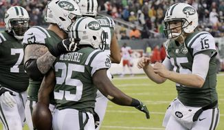 In this Dec. 3, 2017, photo, New York Jets quarterback Josh McCown, right, celebrates with teammates after scoring a two-point conversion during the second half of an NFL football game against the Kansas City Chiefs in East Rutherford, N.J. McCown was widely viewed as simply a place holder, a veteran who would bridge the gap until the next franchise quarterback stepped up and took his spot under center. But a funny thing happened along the way: The 38-year-old McCown has had the best season of his 15-year career, established himself as an emotional leader. Coach Todd Bowles reiterated on Wednesday, Dec. 6, that McCown will be New York's starter for the final four games of the regular season. (AP Photo/Bill Kostroun)