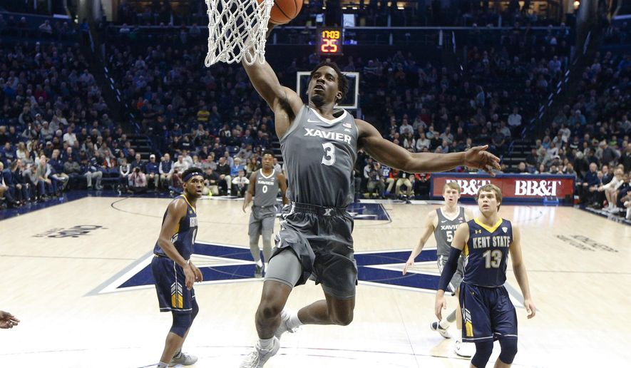 Xavier's Quentin Goodin (3) dunks during the first half of the team's NCAA college basketball game against Kent State, Wednesday, Dec. 6, 2017, in Cincinnati. (AP Photo/John Minchillo)