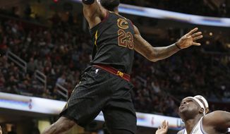 Cleveland Cavaliers' LeBron James (23) drives to the basket against Sacramento Kings' Zach Randolph (50) in the first half of an NBA basketball game, Wednesday, Dec. 6, 2017, in Cleveland. (AP Photo/Tony Dejak)