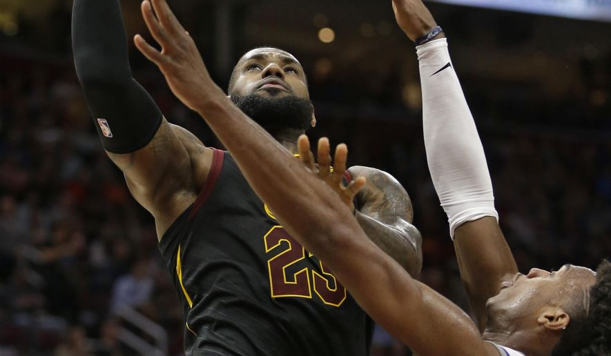 Cleveland Cavaliers' LeBron James (23) drives to the basket against Sacramento Kings' Buddy Hield (24), from the Bahamas, in the first half of an NBA basketball game, Wednesday, Dec. 6, 2017, in Cleveland. (AP Photo/Tony Dejak)