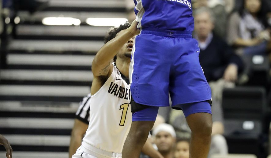 Middle Tennessee forward Nick King (5) grabs a rebound in front of Vanderbilt guard Payton Willis (1) in the second half of an NCAA college basketball game Wednesday, Dec. 6, 2017, in Nashville, Tenn. Middle Tennessee won 66-63. (AP Photo/Mark Humphrey)