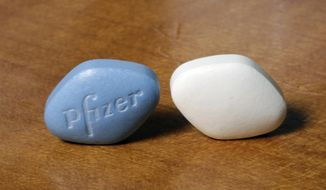 This Monday, Dec. 4, 2017, photo shows a tablet of Pfizer's Viagra, left, and the company's generic version, sildenafil citrate, at Pfizer Inc., headquarters in New York. The drugmaker is launching its own cheaper generic version of Viagra rather than lose sales when its impotence pill gets its first generic competition. (AP Photo/Richard Drew)