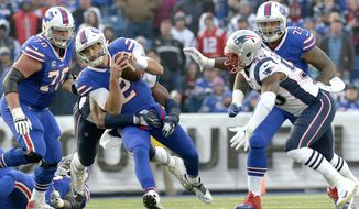 Buffalo Bills quarterback Nathan Peterman (2) scrambles as New England Patriots defensive tackle Deatrich Wise, back, grabs at him for a tackle during the second half of an NFL football game, Sunday, Dec. 3, 2017, in Orchard Park, N.Y. (AP Photo/Adrian Kraus)