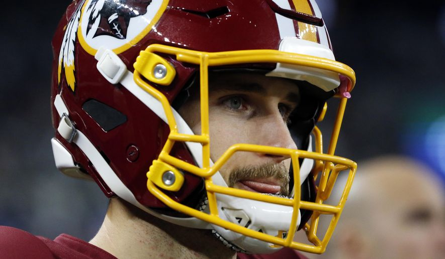 FILE - In this Thursday, Nov. 30, 2017, file photo, Washington Redskins quarterback Kirk Cousins watches play from the sideline in the second half of an NFL football game against the Dallas Cowboys in Arlington, Texas. With the Redskins essentially out of playoff contention, their biggest question moving forward concerns the future of Cousins, who is again set to be a free agent after consecutive seasons on the franchise tag.  (AP Photo/Michael Ainsworth, File)