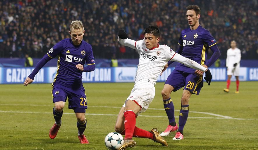 Sevilla's Joaquin Correa fights for the ball with Maribor's Martin Milec, left, and Gregor Bajde, right, during the group E Champions League soccer match between Maribor and Sevilla at the Ljudski Vrt stadium in Maribor, Slovenia, Wednesday, Dec. 6, 2017. (AP Photo/Darko Bandic)