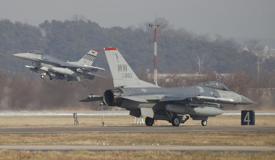 U.S. Air Force F-16 fighter jets take part in a joint aerial drills called Vigilant Ace between U.S and South Korea, at the Osan Air Base in Pyeongtaek, South Korea, Wednesday, Dec. 6, 2017. (Kim Hong-Ji/Pool Photo via AP) ** FILE **