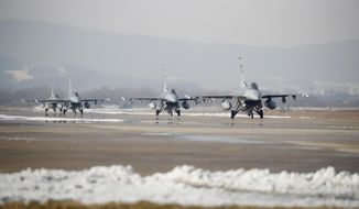 U.S. Air Force F-16 fighter jets take part in a joint aerial drills called Vigilant Ace between U.S and South Korea, at the Osan Air Base in Pyeongtaek, South Korea, Wednesday, Dec. 6, 2017. The five-day drill is meant to improve the allies' wartime capabilities and preparedness, South Korea's defense ministry said. (Kim Hong-Ji/Pool Photo via AP)