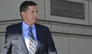 In this Dec. 1, 2017 photo, former Trump national security adviser Michael Flynn leaves federal court in Washington.  A whistleblower has told House Democrats that during President Donald Trump's inauguration speech, Flynn texted a former business associate to say a private nuclear proposal Flynn had lobbied for would have his support in the White House.  (AP Photo/Susan Walsh)
