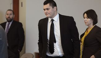 In this Tuesday, Dec. 5, 2017 photo, Osa Masina appears in court for his sentencing hearing at the Matheson Courthouse in Salt Lake City. Masina, a suspended University of Southern California football player who pleaded guilty to misdemeanor sexual assault, has been sentenced to one year in a Utah jail. The Deseret News reports that 20-year-old Masina, a Utah native, was sentenced Tuesday, Dec. 5, 2017, for three counts of sexual battery. (Francisco Kjolseth/The Salt Lake Tribune, via AP, Pool)