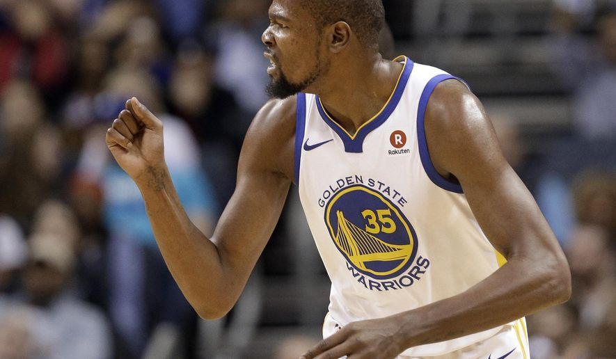 Golden State Warriors' Kevin Durant reacts to making a dunk against the Charlotte Hornets during the first half of an NBA basketball game in Charlotte, N.C., Wednesday, Dec. 6, 2017. (AP Photo/Chuck Burton)