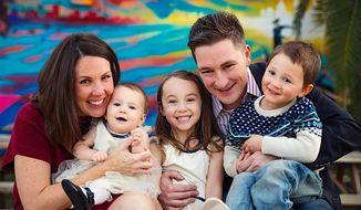 Libertarian National Committee Chairman Nicholas Sarwark, seen with his wife, Valerie, and their children, is running for mayor of Phoenix. (Sarwark for Phoenix)