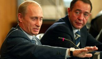 Mikhail Lesin (right) served as a top press aide to Russian President Vladimir Putin until 2009. As his broadcast network RT expanded, he had a falling-out with Mr. Putin, one American intelligence source said, and he moved his family to California. (REUTERS/ITAR-TASS/KREMLIN PRESS SERVICE)