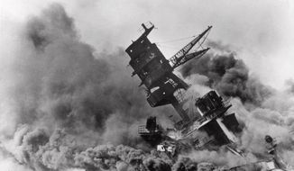 Smoke rises from the battleship USS Arizona as it sinks during a Japanese surprise attack on Pearl Harbor, Hawaii. Saturday marks the 72nd anniversary of the attack that brought the United States into World War II. (AP File Photo)