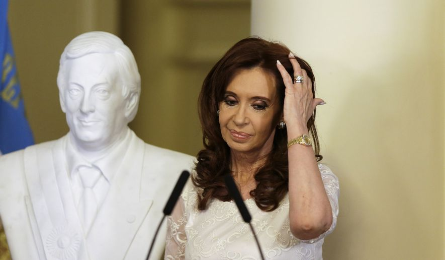 In this Dec. 9, 2015, file photo, then-Argentina's President Cristina Fernandez takes part in an unveiling a bust of her late husband, and former President Nestor Kirchner, at the presidential palace in Buenos Aires, Argentina. An Argentinian federal judge on Thursday, Dec. 7, 2017, accused Fernandez of the crime of treason as he asked lawmakers to remove Fernandez's immunity from prosecution as a senator. (AP Photo/Ricardo Mazalan, File)
