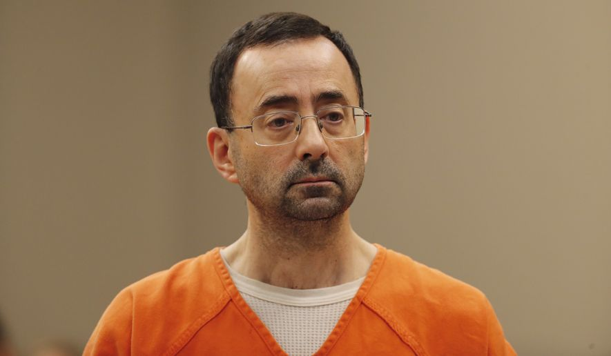 In this Nov. 22, 2017, file photo, Dr. Larry Nassar, appears in court for a plea hearing in Lansing, Mich. Nassar, an elite Michigan sports doctor who possessed child pornography and assaulted gymnasts, was sentenced Thursday, Dec. 7, 2017, to 60 years in federal prison in one of three criminal cases that ensure he will never be free again. (AP Photo/Paul Sancya, File)