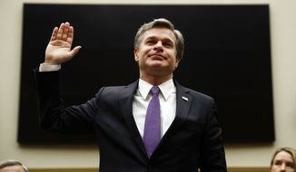 "FBI Director Christopher Wray was warned he was close to ""walking into contempt of Congress"" after refusing to comment on numerous matters involving Peter Strzok. (Associated Press)"