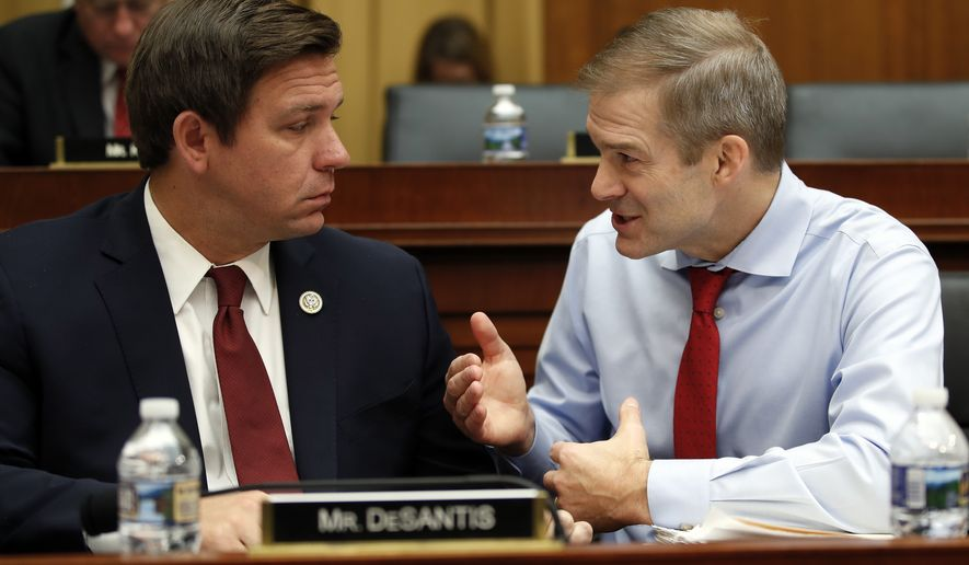 House Judiciary Committee member Rep. Jim Jordan, R-Ohio, right, and Rep. Ron Desantis, R-Fla., talk as FBI Director Christopher Wray testifies during a House Judiciary hearing on Capitol Hill in Washington, Thursday, Dec. 7, 2017, on Oversight of the Federal Bureau of Investigation. (AP Photo/Carolyn Kaster)