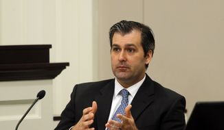 In a Nov. 29, 2016 file photo, former North Charleston police officer Michael Slager testifies during his murder trial at the Charleston County court in Charleston, S.C. Slager was sentenced to 20 years in prison Thursday, Dec. 7, 2017, for 2015 fatal shooting of unarmed black motorist Walter Scott. (Grace Beahm/Post and Courier via AP, Pool, File)